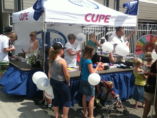 Lots of kids and families visited CUPE 411's new tent at the Chilliwack Classic Car Show.